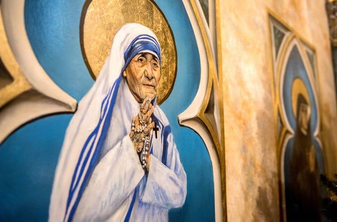 A series of painting of Saints like Mother Teresa line part of the sanctuary of St. Mark's Catholic Church  in Peoria, Ill. Peoria artist Andrew Hattermann and the artists of Murals by Jericho have built a successful business painting and beautifying churches all over the country and the world.