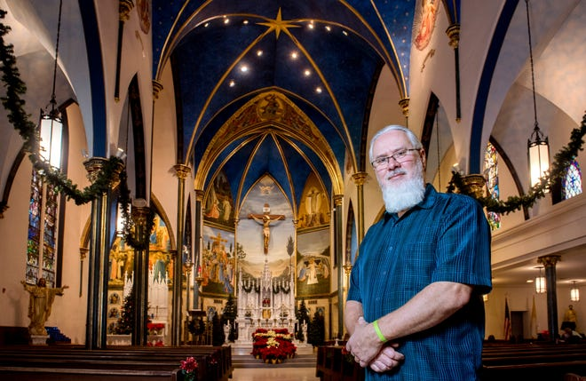 Peoria artist Andrew Hattermann stands in the sanctuary of St. Mark's Catholic Church in Peoria, Ill.. Hattermann and the artists of Murals by Jericho have built a successful business painting and beautifying churches all over the country and the world.