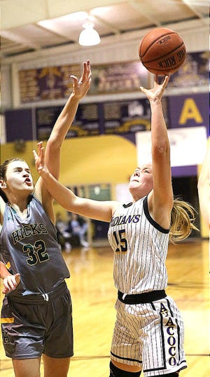 Anacoco's Bailey Davis (15) goes up for a shot against Hicks' forward Maci Charrier in a Lady Pirate win over the Lady Indians, 54-28