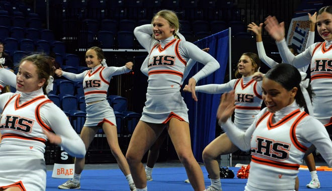 Lakeland cheerleaders perform at the University of Florida during the FHSAA Class 2A competitive cheerleading state championship on Friday.