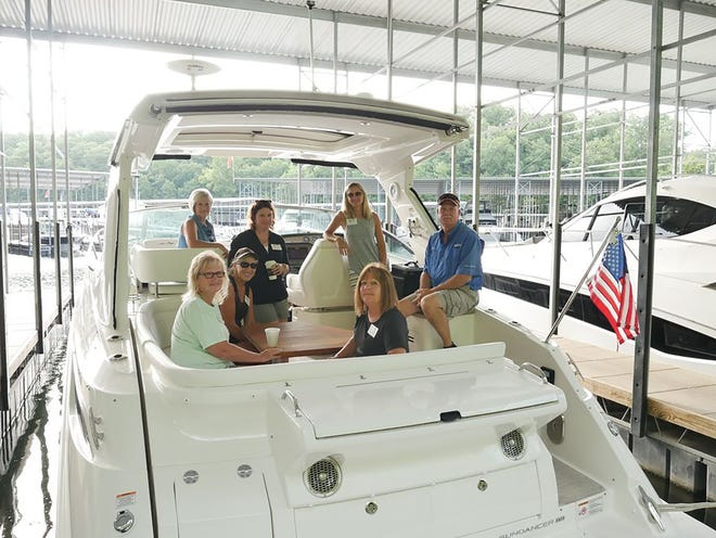 MarineMax offers an introductory Women on Water class that covers basic boating tips and focuses on teaching ladies how to safely drive and dock a boat.Pictured, instructor Greg Riley with Women on the Water participants.