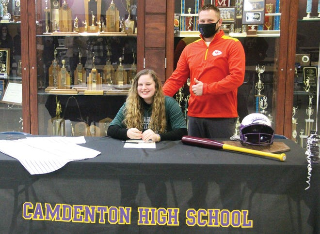 Camdenton senior Sadie Stockman (left) and Coach Tyler Dinsdale (right) at Stockman's signing ceremony on Thursday, January 7, in Camdenton. Stockman will play softball for Central Methodist University.