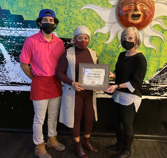 """The Chamber of Commerce for Greater Milford presented Bibi's Restaurant and Bar with the """"Best Tastes"""" Award from the 2020 Annual Holiday Auction & Tastes of Milford. Pictured are Arlleneiri Rodriguez and Guadalupe Garcia Hernandez, Bibi's Restaurant & Bar, and Committee Co-Chairperson Kim Rigby, People's Place communications and donor relations manager."""