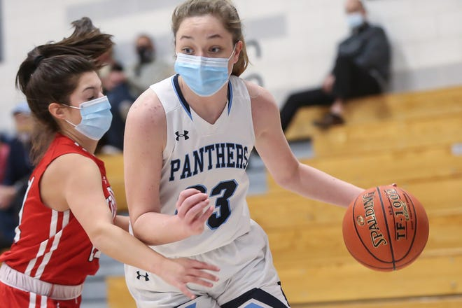 Franklin High junior captain Olivia Quinn drives to the basket during a game against Milford at Franklin High School on Jan. 7. The Panthers beat the Scarlet Hawks, 71-23.