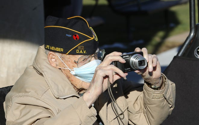 A birthday parade was held outside the New Horizons assisted living facility in Marlborough for 100-year-old Army veteran Arthur Butler, Jan 8, 2021. He took photos through it all. [Daily News and Wicked Local Staff Photo/Ann Ringwood]