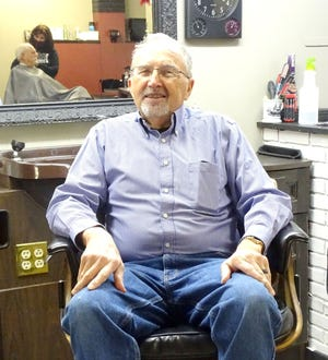 Rex Browning relaxes in the chair he has commanded for the past 60 years before retiring this past Saturday.