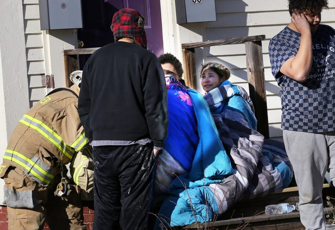 Many residents of an apartment building at 61 Lafayette St. in Rochester were forced from their homes after a fire ripped through it Friday, Jan.8, 2021.