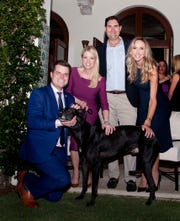 From left, U.S. Rep. Matt Gaetz, R-Fla.; lobbyist Pam Bondi; animal welfare advocate Blair Brandt; and Lara Trump, the former president's daughter-in-law, attend a fundraiser Feb. 8,  2019, in Palm Beach, Fla., to support the Humane Society's efforts to find homes for greyhounds, such as Bart, a racing dog saved from being euthanized after he broke his leg.