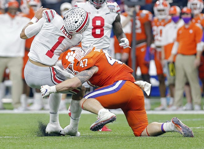 Ohio State quarterback Justin Fields, getting hit by Clemson's James Skalski during the College Football Playoff semifinal on Jan. 1, sat out one snap after the hit that saw the linebacker ejected, before returning to throw a touchdown pass.