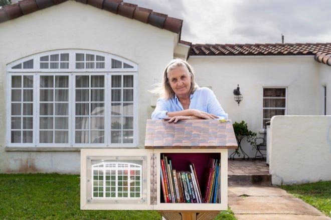 Mary Lindsey is behind the Little Free Libraries project in Lake Worth Beach and oversees more than 100 of the locations, including one in front of her home.