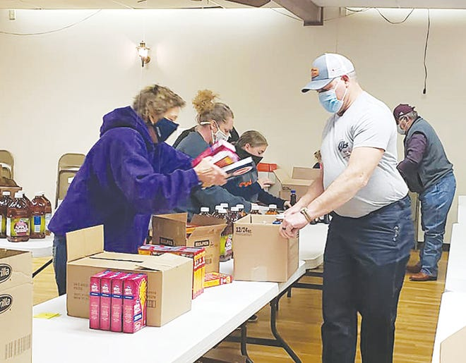 Pratt Elks Lodge members and families gathered to pack donated food items for gift boxes that were distributed to 30 local families before Christmas