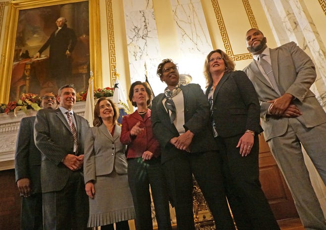 Gov. Gina Raimondo poses with judicial nominees in 2018. From left: Christopher Knox Smith, Richard Merola, Susan Pepia Fay, Raimondo, Melissa DuBose, Melissa Darigan and Keith Cardoza. [The Providence Journal/Sandor Bodo]