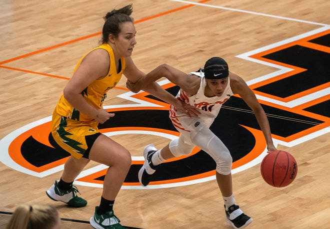 Pacific's Lianna Tillman right, drives around San Francisco's Jessica McDowell-White at Spanos Center in Stockton.