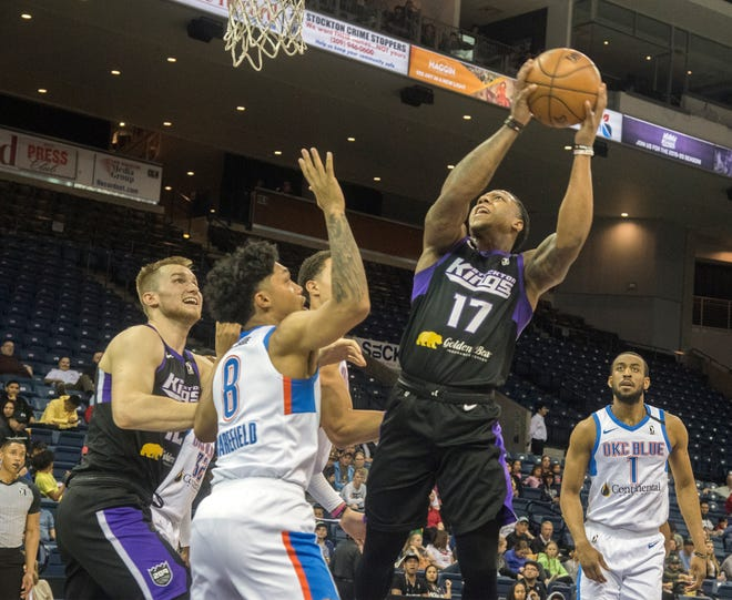 Stockton Kings' Isaiah Canaan, right, goes to the hoop against Oklahoma City Blue's Sedrick Barefield during a NBA G-League game March 11 at Stockton Arena.