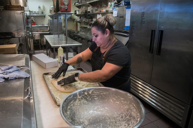 Head chef Ruby Lopez makes focaccia bread for Mezzo restaurant, one of the participating restaurants in Stockton Restaurant Week.