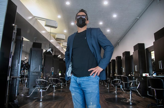 Dino Ballin, owner of the Pomp Salon in Lincoln Center, is one of many business owners in the region who have remained defiant against sweeping lockdown orders that went into effect last month for most of California as intensive care unit capacity dropped dramatically