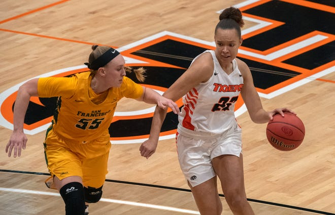 Pacific's Valerie Higgins, right, drives on USF's Abby Rathbun during a WCC women's basketball game at Spanos Center in Stockton.