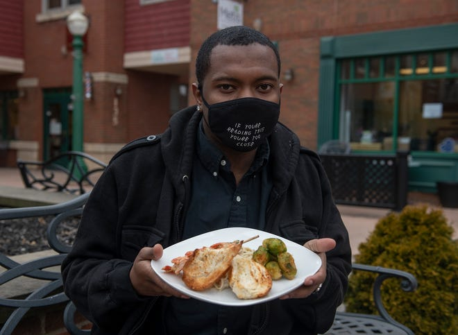 Brendan Daniels-Smith is the owner of D-S Food Prep Co. based in Kent. Daniels-Smith shows off his shrimp linguine, steamed and sauteed brussel sprouts with crostini.