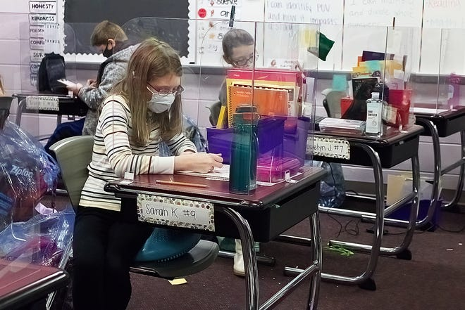 Crestwood fourth-grader Sarah Kennerknecht works on her Percy Jackson project Friday.