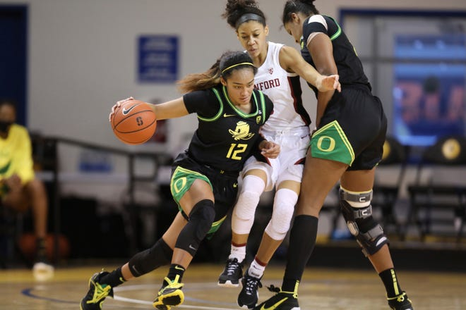 Oregon's Te-Hina Paopao (12) tries to get past Stanford guard Anna Wilson during the second half of Friday's game in Santa Cruz, Calif.