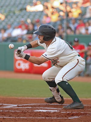 Former Jackson High School star Kyle Mottice attempts to bunt during a 2019 game with the Greensboro Grasshoppers, a Pittsburgh Pirates minor league affiliate. Mottice signed a minor league deal with the San Francisco Giants this week.