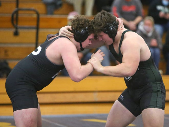 Aidan Fockler (left) of Perry defeated Aeden Begue of GlenOak in a heavyweight bout at Perry on Thursday, Jan. 7, 2021.