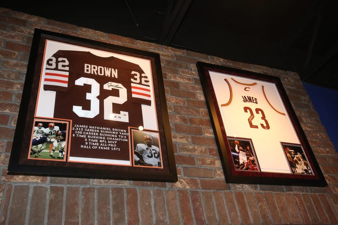 Sports memorabilia is shown on the walls of Jerzee's All American Sports Grill in Jackson Township on Thursday, Jan. 7, 2021. Sports bars like Jerzee's are upset that they won't be able to stay open past 10 p.m. on Sunday or Monday for the Cleveland Browns playoff game and the Ohio State national title game. Gov. Mike DeWine says he will not extend the curfew because it would lead to a lot of private parties, which will add to the spread of COVID-19.