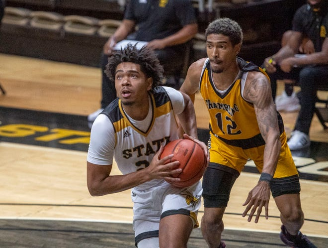 Former Rockford Lutheran star Kenny Strawbridge of Alabama State takes the ball to the basket in the 2021 season opener against Grambling.