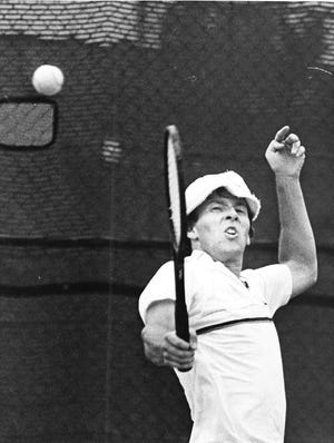 Nine-time Rockford City tennis champion John Torrence hits a backhand during the 1985 tourney.