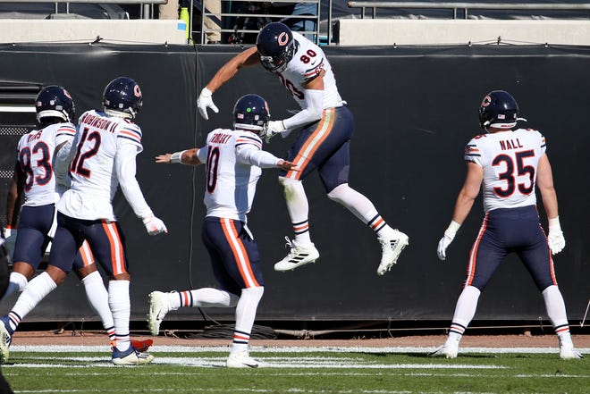 Chicago Bears tight end Jimmy Graham, second from right, celebrates his touchdown catch against the Jacksonville Jaguars with teammates Javon Wims (83), Allen Robinson II (12), quarterback Mitchell Trubisky (10) and Ryan Nall (35) during the first half Dec. 27 in Jacksonville, Fla.