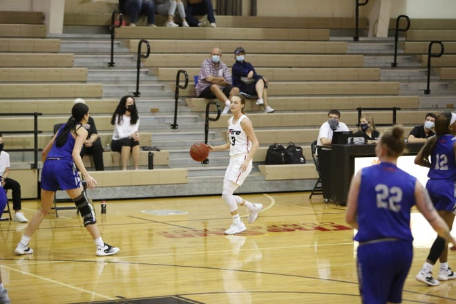 Madi Hecox, the former East and RVC star who is now the starting shooting guard for Southeastern University in Lakeland, Florida, dribbles the ball up the court in a recent NAIA women's basketball game. Hecox had heart surgery a little over a year ago, but is now back on the court, and is also trying to help others off the court.