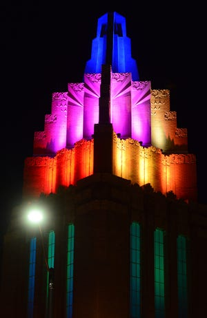 Multi-colored lights illuminated the newly restored tower and spire atop the The Stiefel Theatre in downtown Salina during the Grand Tower Reveal & Premier Light Show outside of the theatre on Thursday evening.