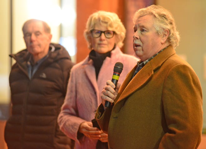 Jon Richards, chairman of the Stiefel Theatre Board of Directors, thanks The Friends of the Stiefel Theatre for supporting the theatre and the renovations after Jane Gates, executive director, and Norm Yenkey (left), who headed of the tower and renovation projects, spoke to community members before the Grand Tower Reveal & Premier Light Show outside of the theatre on Thursday evening.