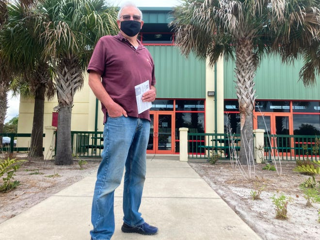 Jeff Hillier, of St. Augustine, stands outside of the Solomon Calhoun Center in St. Johns County after receiving his first dose of the Moderna vaccine. Hillier was one of 400 people expected to receive a dose on Friday. Many others, including his wife, were unable to book an appointment. St. Johns County government will begin booking new appointments as soon as more vaccine doses are available.