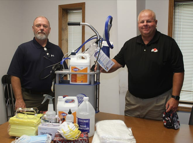 Director of Environmental and Occupational Safety Barry Lane, left, and Director of Facilities and Maintenance David Wacaster with testing supplies Gardner-Webb University will use this semester.