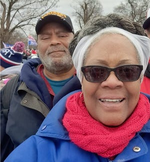 Tanzy Barrow Wallace poses for a selfie with her husband, Stephen Wallace, in Washington, DC, this week.
