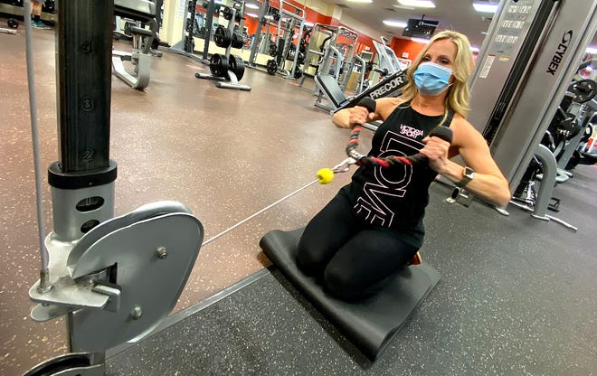 Donna Self works out at the Dover Foundation YMCA on Friday.