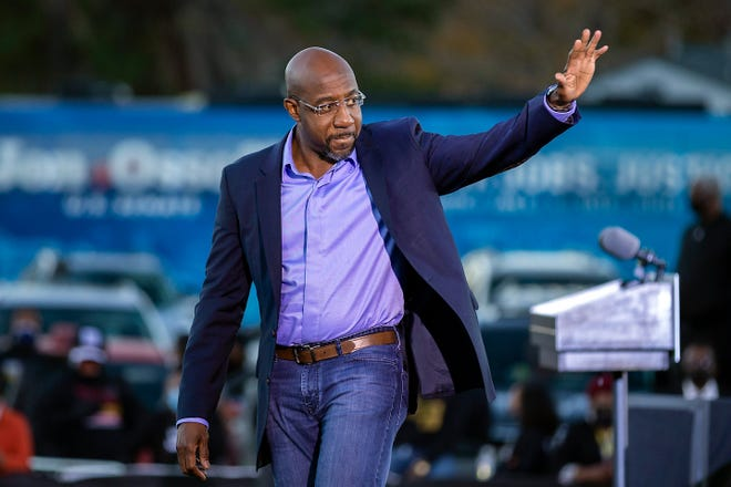 Democratic U.S. Senate candidate Rev. Raphael Warnock waves to supporters during a drive-in rally, Sunday, Jan. 3, 2021, in Savannah, Ga. Warnock won his runoff election on Tuesday, Jan. 5. He is the senior pastor of Ebenezer Baptist Church, where Dr. Martin Luther King Jr. also served.