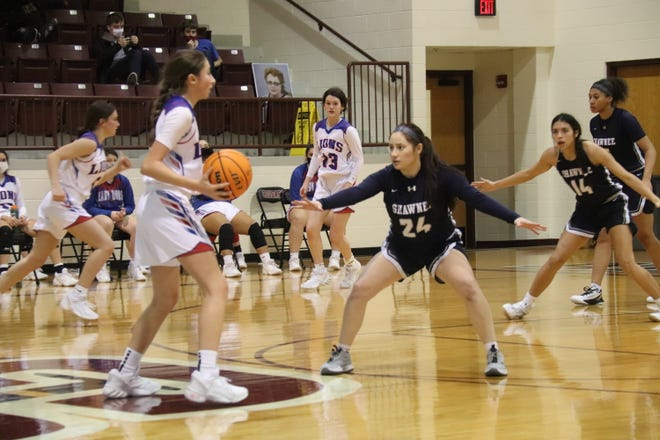 Shawnee's Kaitlyn Taylor (24) guards a Durant player while teammate Kailey Henry (14) defends in the background Thursday during the first round of the East Central Oklahoma Classic at Ada High School.