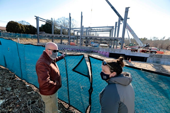 New Bedford City Councilor William Brad Markey and Alma del Mar Director of Development Becca Kurie check in on the progress of the new Alma del Mar school being built on Church Street in New Bedford.