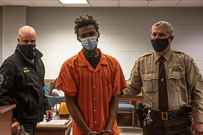 Rayshawn Vredenburg is led from the courtroom after his first appearance. He is charged with the murder of Jamal Gardner. [Bill Hand / Sun Journal Staff]