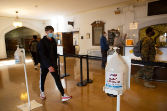 Bottles of hand sanitizer stand ready for students as they enter Topeka High School on Thursday afternoon.