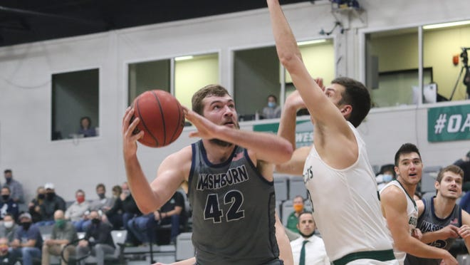 Jonny Clausing (42) came up huge in helping No. 5 Washburn knock off No. 1 Northwest Missouri 84-82 in overtime Thursday in Maryville, Mo. Clausing scored 21 points on 10-of-13 shooting and had a huge block late in overtime to help seal the victory.