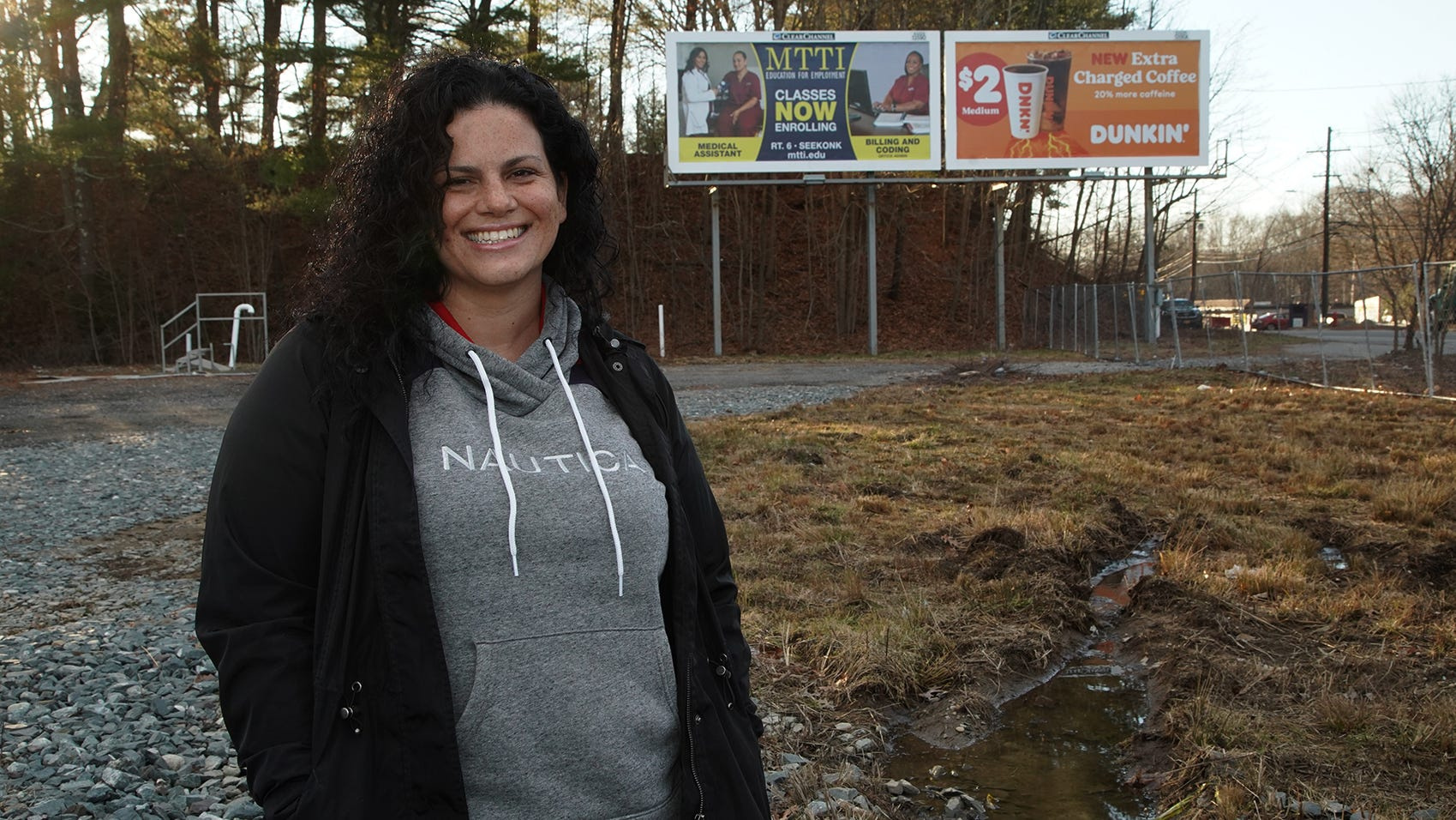 Kyra Fernandez stands on the site of her future retail marijuana store at 354 Winthrop St. in Taunton on Jan. 7, 2021. She is one of the applicants awarded a marijuana license by the Taunton City Council on Dec. 28, 2020.