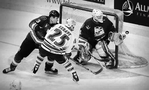 Worcester IceCats forward Chris Kenady (25) flips a shot wide of the Kentucky Thoroughblades goal during a game in March 1998.