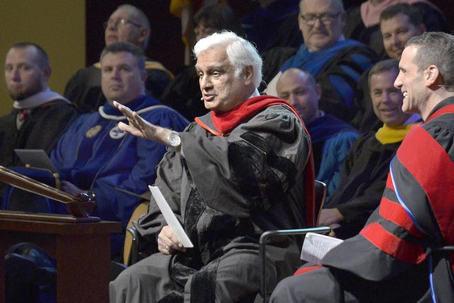 Ravi Zacharias, center, who built an international ministry that strives to defend Christianity on intellectual grounds, died Tuesday, May 19, 2020, at his home in Atlanta after a brief battle with cancer.