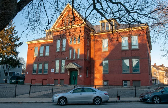 The rear of the University Park Campus School seen from Lowell Street, the former Freeland Street School in Worcester.