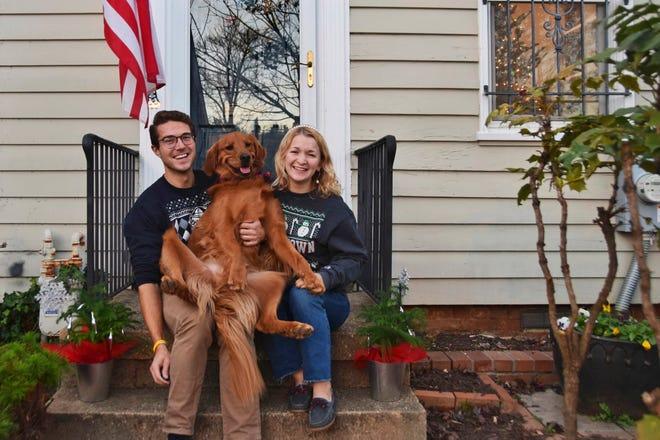 Olivia Hinerfeld poses with her boyfriend, Ryan Shymansky, and their golden retriever Lincoln in Washington.
