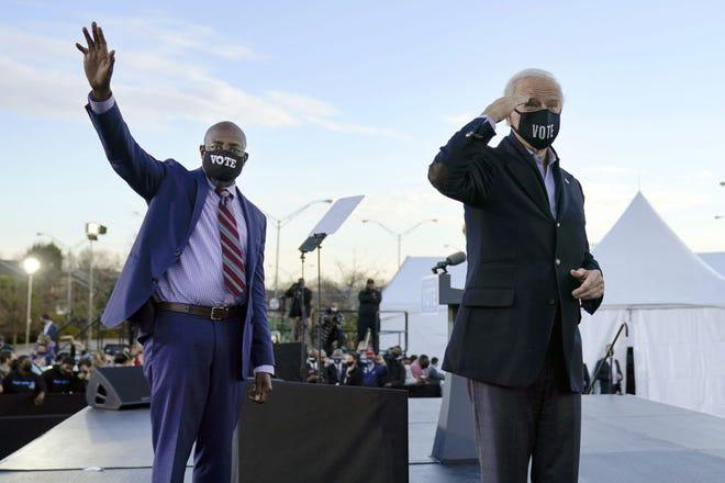President-elect Joe Biden, right, campaigns for Senate candidates Raphael Warnock, left, and Jon Ossoff, not pictured, Jan. 4 in Atlanta.