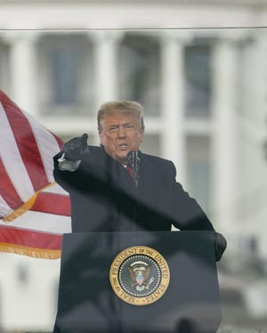 President Donald Trump speaks during the Jan. 6 rally protesting the electoral college certification of Joe Biden as president, in Washington.